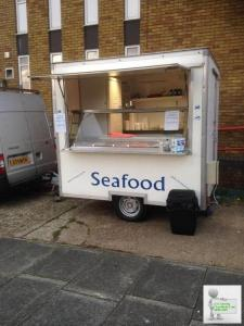 Seafood trailer currently set up and working pitches